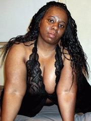 Chubby black babe in black Corsets